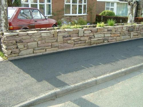 Stone wall jet washing after