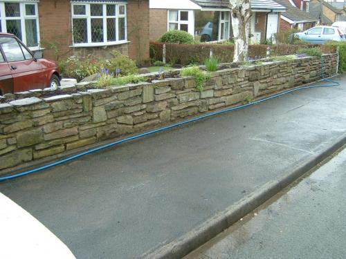 Stone wall jet washing before